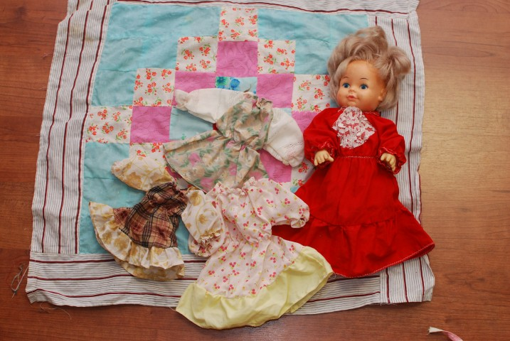 Doll quilt and clothes I made.
