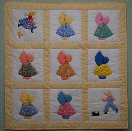 A lady brought me these sunbonnet blocks and I made her a little baby quilt out of them.
