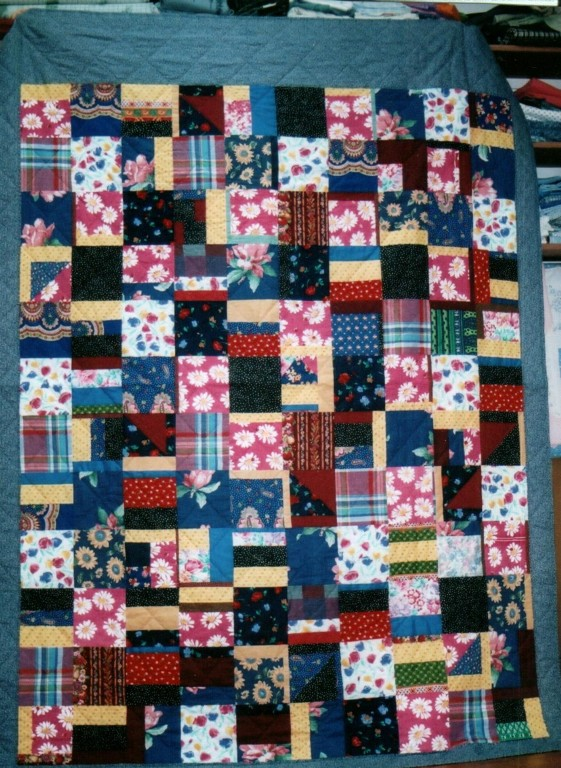 scrap quilt from a box of free fabric scraps--maybe not so lovely, but oh so comfy and useful!