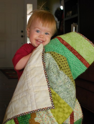 My nephew loving his quilt
